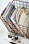 Magazines in vintage wire basket