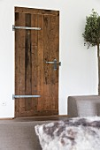 Rustic interior door with wrought iron fittings and latch