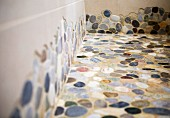 Bathroom floor tiled with mosaic pebbles