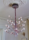 Modern Birds Birds Birds designer pendant lamp featuring stylised flying light bulbs suspended from stucco ceiling