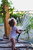 Toddler playing with water on terrace