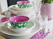 White place setting with colourful bowl and romantic pattern