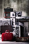 Various suitcases and bags arranged against grey background