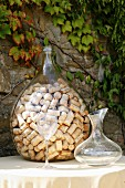 Collection of wine bottle corks in demijohn