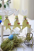 Easter bunnies hand-crafted from fabric remnants and cardboard
