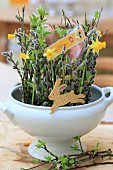 Flower arrangement and Easter decorations in white soup tureen
