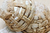Woven baskets of bread dough for Easter table