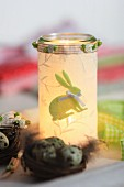 Candle lantern covered in fabric decoupage with felt Easter bunny motif