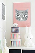 Cardboard storage boxes and comic-style figurines in corner of nursery