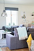 Retro pendant lamps with metal lampshades above sofa combination in shades of grey