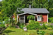 Small wooden house in summery garden