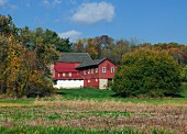 Red farmhouse in country
