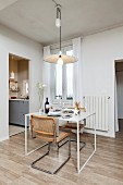 Small dining table and two cantilever, cane chairs