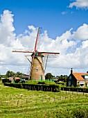 Old windmill on edge of village