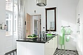 Modern kitchen in black and white colour scheme and pastel green accents