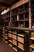 Wood and stone shelving in rustic wine cellar