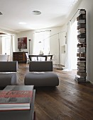 Designer easy chairs on rustic wooden floor in renovated interior