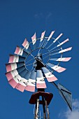 Windmill against blue sky