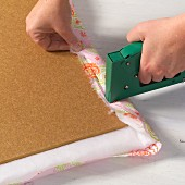 Hand-crafting a pinboard - stapling fabric to a backing board