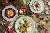 Christmas dinner, potato pancake with smoked salmon and beetroot, quail with Brussels sprouts and parsnip puree, Mont Blanc pavlova with chestnut puree