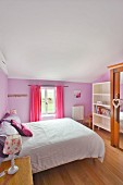 Romantic bedroom with lavender-painted walls and lilac and pink textiles