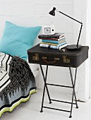 A homemade bedside table – a suitcase on a vintage-style metal side table