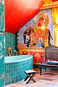 Indian-style decor in bathroom with elephant mahout motif, turquoise ornamental tiles on bath surround and wall