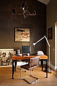 Retro cantilever chairs with leather covers at postmodern desk and designer standard lamp against bronze-coloured wall