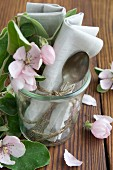 Silver spoon, linen napkin and quince flower in preserving jar