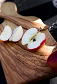 Sliced apple on wooden chopping board