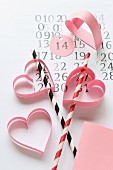 Craft idea for Valentine's Day: hand-crafted, paper love-hearts decorating drinking straws