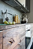 Rustic kitchen base unit with wooden front, chrome kettle and citrus press on worksurface