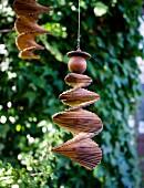 Wooden spiral mobile hanging in garden