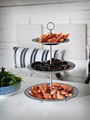 Seafood on cake stand in maritime interior
