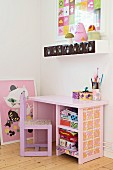 Pink child's chair and desk below spice shelf hung on wall