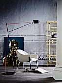 Standard lamp, reading chair, classic column, industrial shelving and distorted portrait leaning against concrete wall