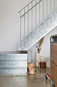 Detail of quarter-turn staircase made of galvanised sheet metal with stainless steel balustrade