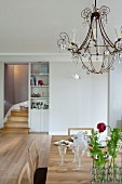 Wrought iron chandelier above table