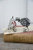 Hand-crafted bird sculptures made from wire and newspaper
