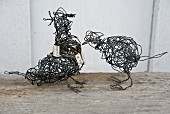 Two wire bird sculptures