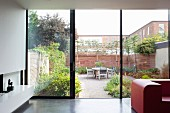 View from interior into courtyard through open sliding door