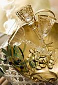 Elegant crystal glasses in silver bowl