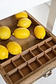 Lemons in vintage wooden tray