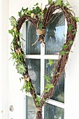 Hand-crafted, heart-shaped wreath made from birch twigs and ivy