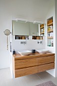 Modern wooden washstand with twin basins and wall-mounted taps
