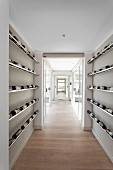 Minimalist wine store in hallway of contemporary house