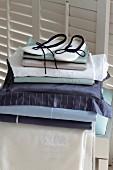 Slippers on stack of elegant bed linen