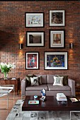 Gallery of pictures on brick wall of loft apartment living room with retro furniture