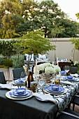 Festively set table on terrace