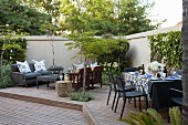Set table and lounge area on courtyard terrace
